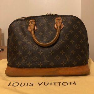 Authentic LOUIS VUITTON  Alma bag authentic